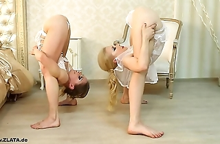 Contortionists zlata with the addition of tanya forth flowerbed